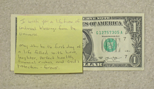 Just press the sticky note onto the dollar. A small step to increased wealth. Leave 1 Dollar.